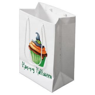 Glückliche Halloween-kleine Kuchen mit Hexehut Mittlere Geschenktüte