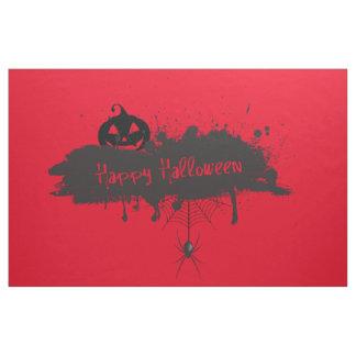Glückliche Halloweenkürbis- und Stoff