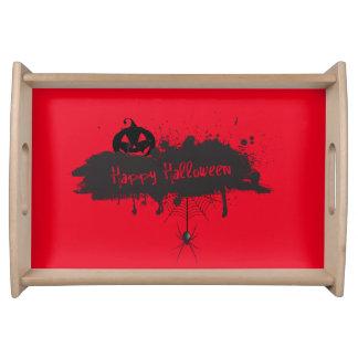 Glückliche Halloweenkürbis- und Tablett