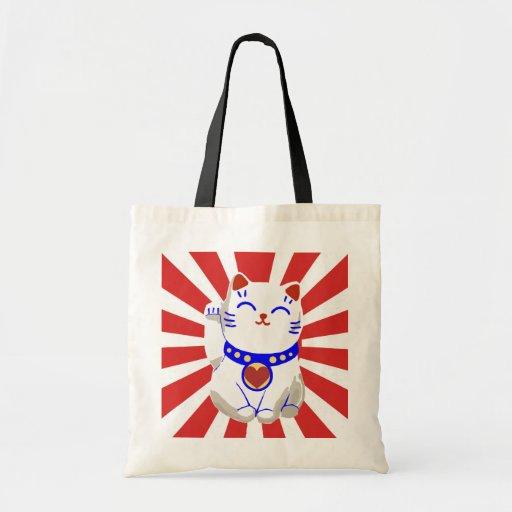 Glückliche niedliche neko Katze auf steigender Son Einkaufstaschen