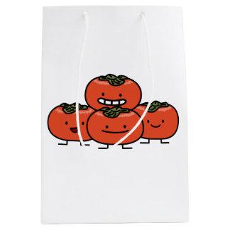 Glückliche Persimone-Paar-Persimone-Bonbon-Frucht Mittlere Geschenktüte