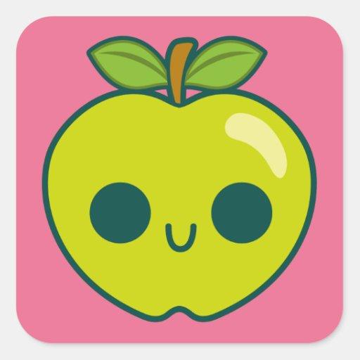 Glückliches grünes Apple auf einem rosa Quadratsticker