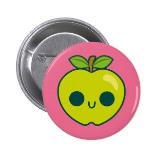 Glückliches grünes Apple auf einem rosa Anstecknadel