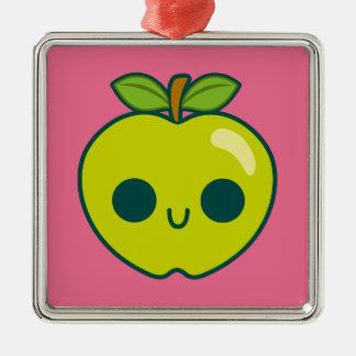 Glückliches grünes Apple auf einem rosa Weihnachtsornament