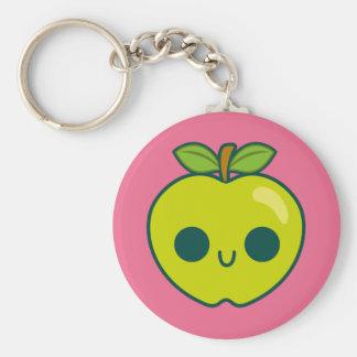 Glückliches grünes Apple auf einem rosa Schlüsselbänder