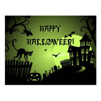 Glückliches schwarze Katzen-Spuk Haus Halloweens Postkarte