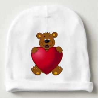 Glückliches teddybear mit Herz-Cartoon-Baby Beanie Babymütze