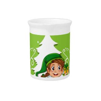 Glückliches Weihnachtsthema mit Elf und Geschenk Getränke Pitcher