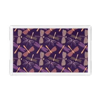 Glühende Nachtlibellen auf dunklem Acryl Tablett
