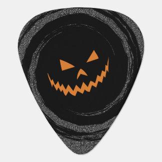 Glühender Jack O'Lantern Halloweens in einem Plektrum