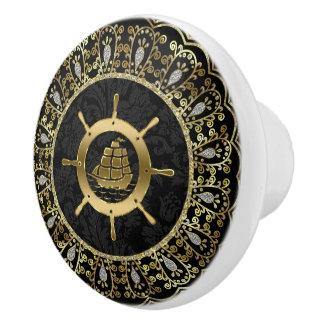 Gold-u. Schwarz-Seeboot u. verzierter Rahmen Keramikknauf