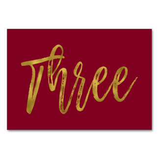 Gold und elegante Tischnummer drei Burgunders
