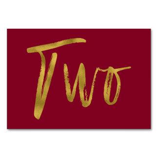 Gold und elegante Tischnummer zwei Burgunders