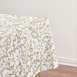 Goldblumenmusik-Muster auf Weiß oder irgendeiner Tischdecke