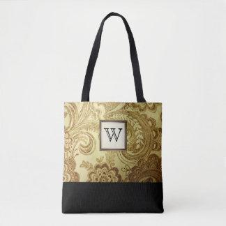Golddamast mit schwarzem Monogramm Tasche