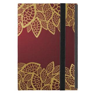 Goldene Blatspitze auf rotem Hintergrund iPad Mini Schutzhüllen