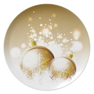 Goldene braune Dekoration des neuen Jahres mit Teller