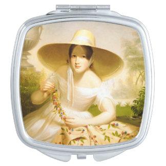 Goldene Frau im Frühjahr Taschenspiegel