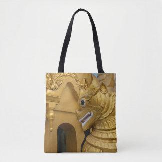 Goldene Löwe-Statue am Tempel Tasche