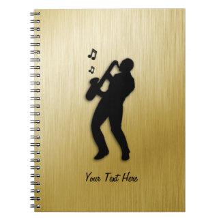 Goldener Saxophon-Spieler Notizblock