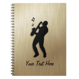 Goldener Saxophon-Spieler persönlich Notizblock