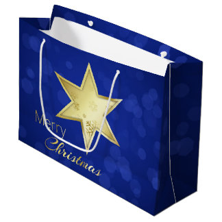 Goldener Weihnachtsstern blaues Bokeh - große Große Geschenktüte