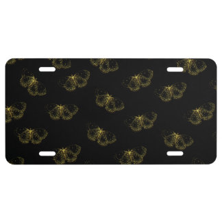Goldmetallische Schmetterlinge auf Schwarzem US Nummernschild