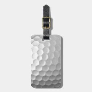 Golfball bildet Beschaffenheits-Muster mit Namen Gepäckanhänger