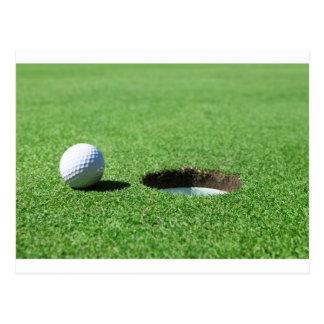 Golfball und Loch Postkarte