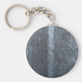 Graue Hintergrundmetallbeschaffenheit reiht Schlüsselanhänger