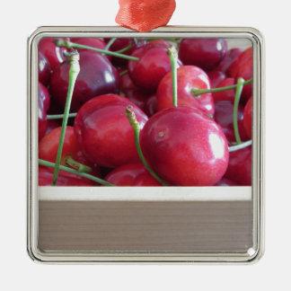 Grenze der frischen Kirschen auf hölzernem Quadratisches Silberfarbenes Ornament