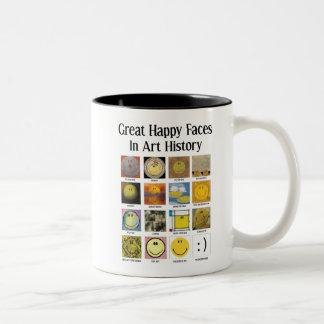 Große glückliche Gesichter in der Zweifarbige Tasse