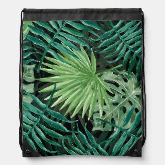 Große grüne Farn-Palme und Monstera tropische Turnbeutel