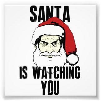 Großer Bruder Weihnachtsmann passt Sie auf Kunstfoto