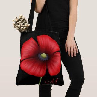 Großes rotes Mohnblumen-Monogramm auf schwarzer Tasche