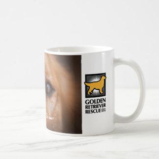 GRRNT Gesicht einer goldenen Tasse