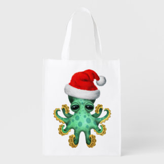 Grüne Baby-Krake, die eine Weihnachtsmannmütze Wiederverwendbare Einkaufstasche