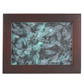 Grüne und weiße Tinte auf schwarzem Hintergrund Erinnerungsdose