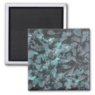 Grüne und weiße Tinte auf schwarzem Hintergrund Quadratischer Magnet