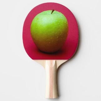 Grüner Apfel auf rotem Hintergrund Tischtennis Schläger
