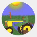 Grüner Traktor mit der Fischerei Pole durch Runder Aufkleber