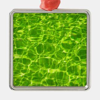 Grünes Neonwasser kopiert Hintergrund-leeres Quadratisches Silberfarbenes Ornament