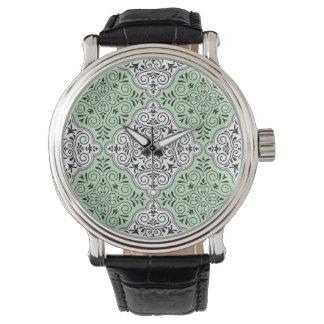 Grünes Rokoko-Muster blühen Uhr