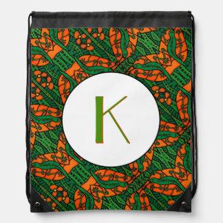 Grünes und orange Eidechsegecko-Muster mit Turnbeutel