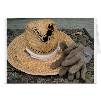 Gut-verwendeter Gartenhut und -handschuhe