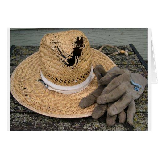 Gut-verwendeter Gartenhut und -handschuhe Grußkarte