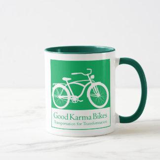 Gutes Karma fährt Tasse rad