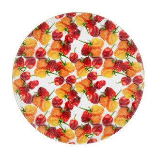 Habanero-Paprika-rote Paprikaschoten-orange heiße Schneidebrett
