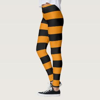 Halloween-Art-orange und schwarzes gestreiftes Leggings