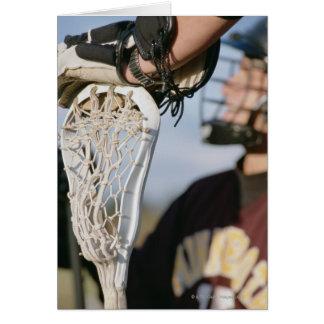 Hand auf einem Lacrosse-Stock Karte